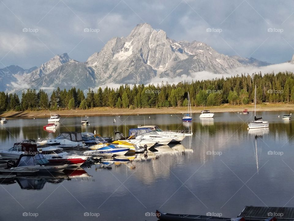 Yellowstone Boats, Lake, Mtn. Lake and marina in Yellowstone with mountains in the background.