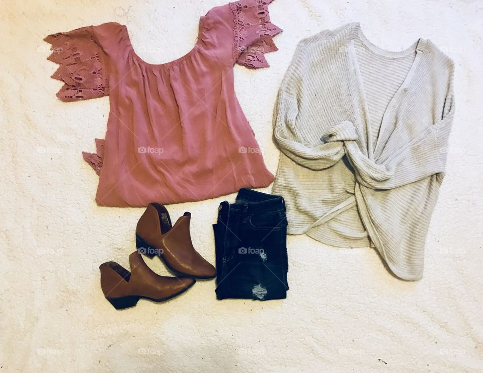 Women and teens fall Fashions : torn denim dark wash jeans , pink baby doll shirt, and off white grey sweater