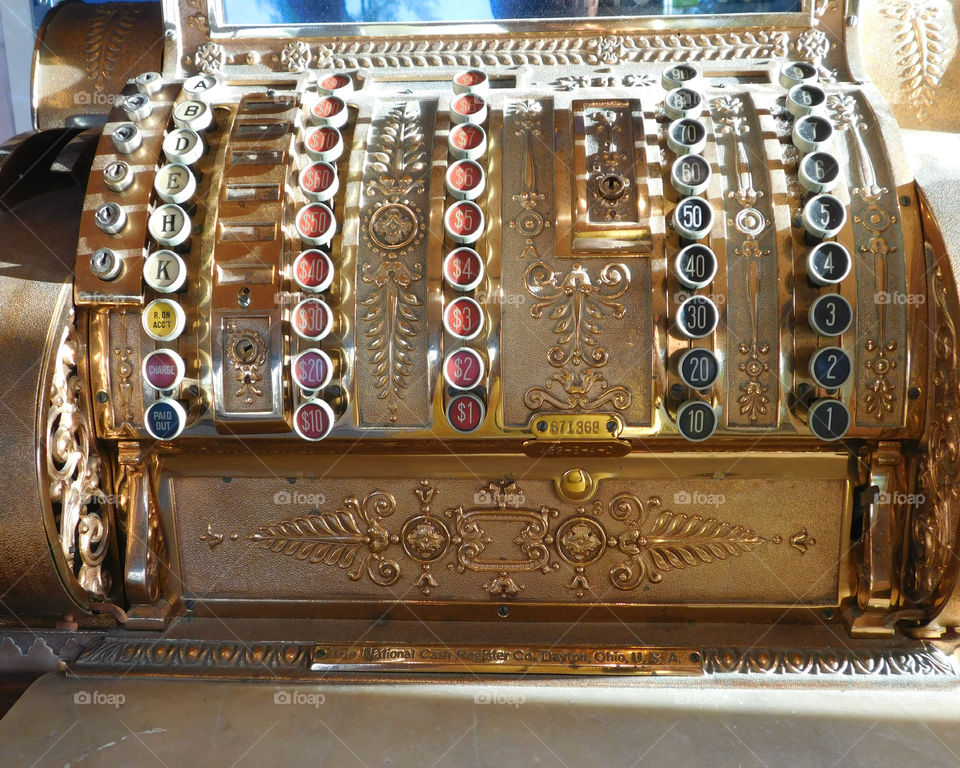 Antique National Cash Register! Notice the beautiful oak cabinet with draws!