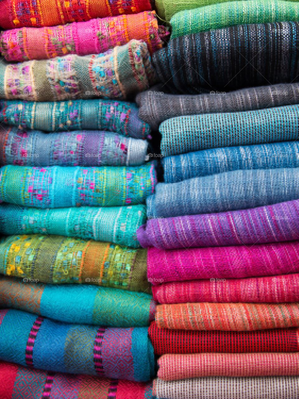 Pile of colourful scarves