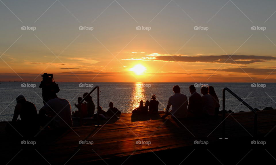 People enjoying the sunset in Malmö.