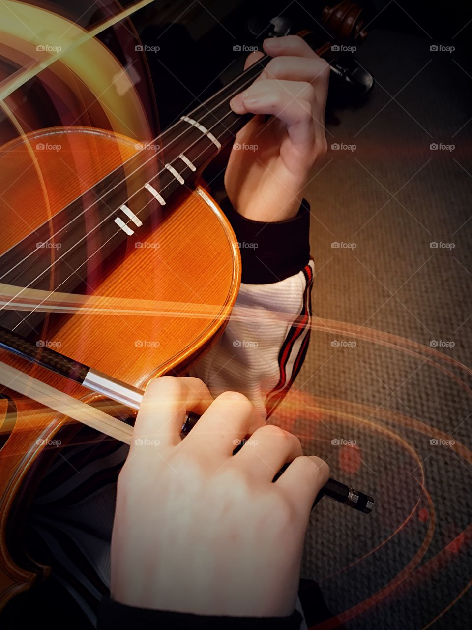 Light and sound. Color hands Playing Violin