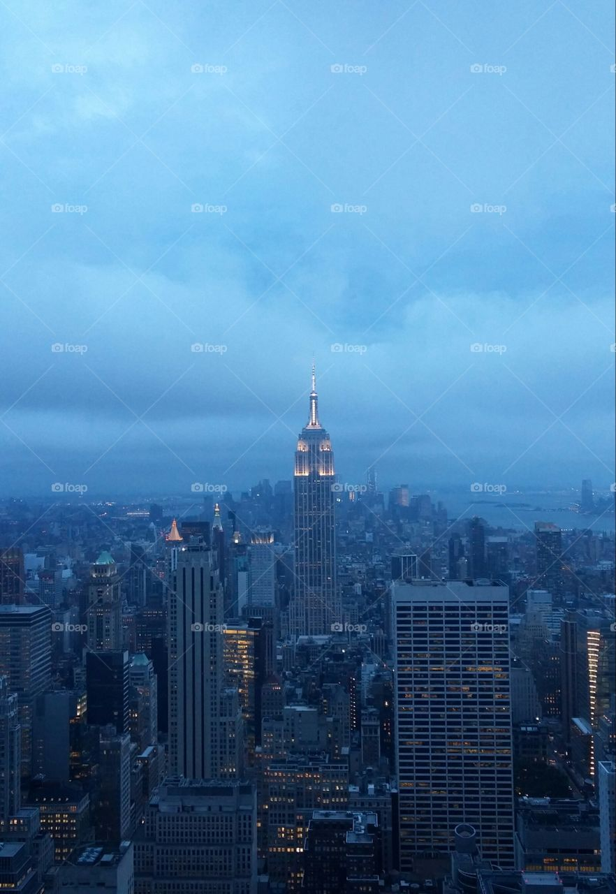 Cloudy Empire State. View of the Empire State Building from the Top of the Rock (Rockefeller Center) on a cloudy but beautiful summer night.
