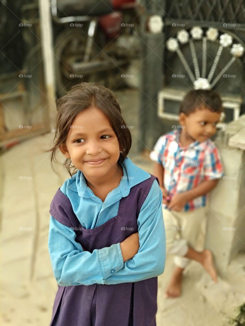 Smiling Indian girl in school uniform