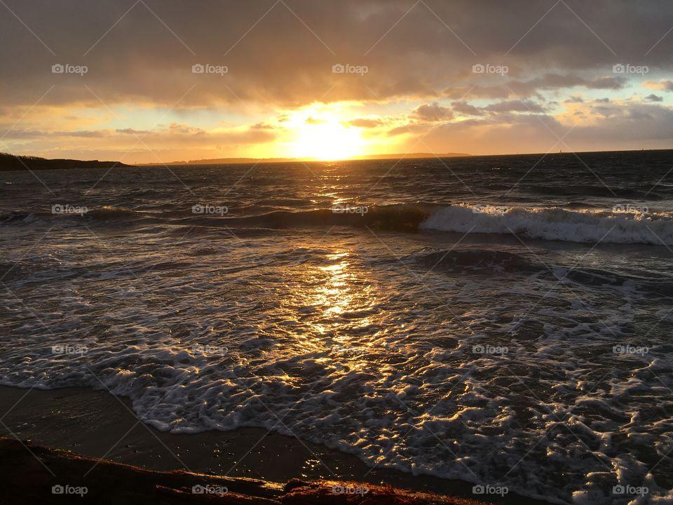 Sunset over wavy sea