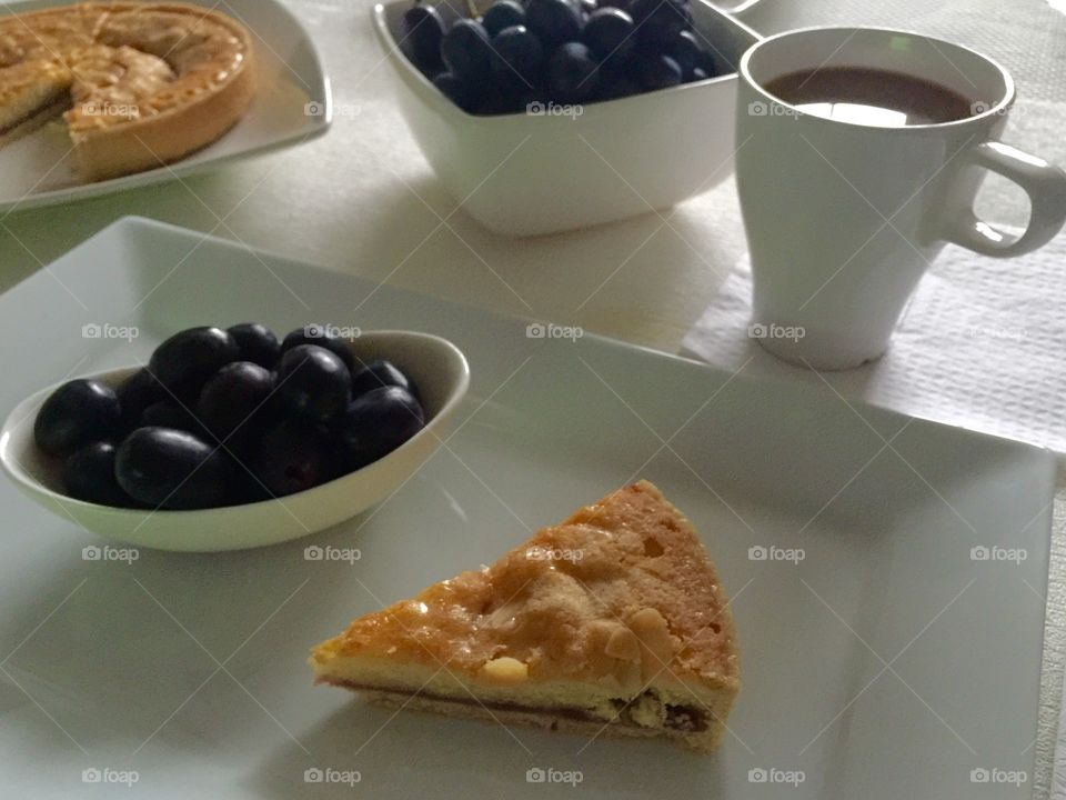 Bakewell tart  with coffee and grapes