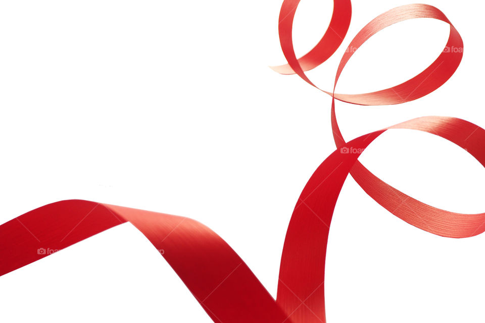 a red ribbon twisted into a spiral on a white background