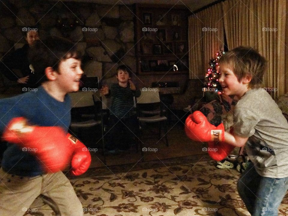Young Boxers. Boys Fighting A Friendly Bout With Boxing Gloves