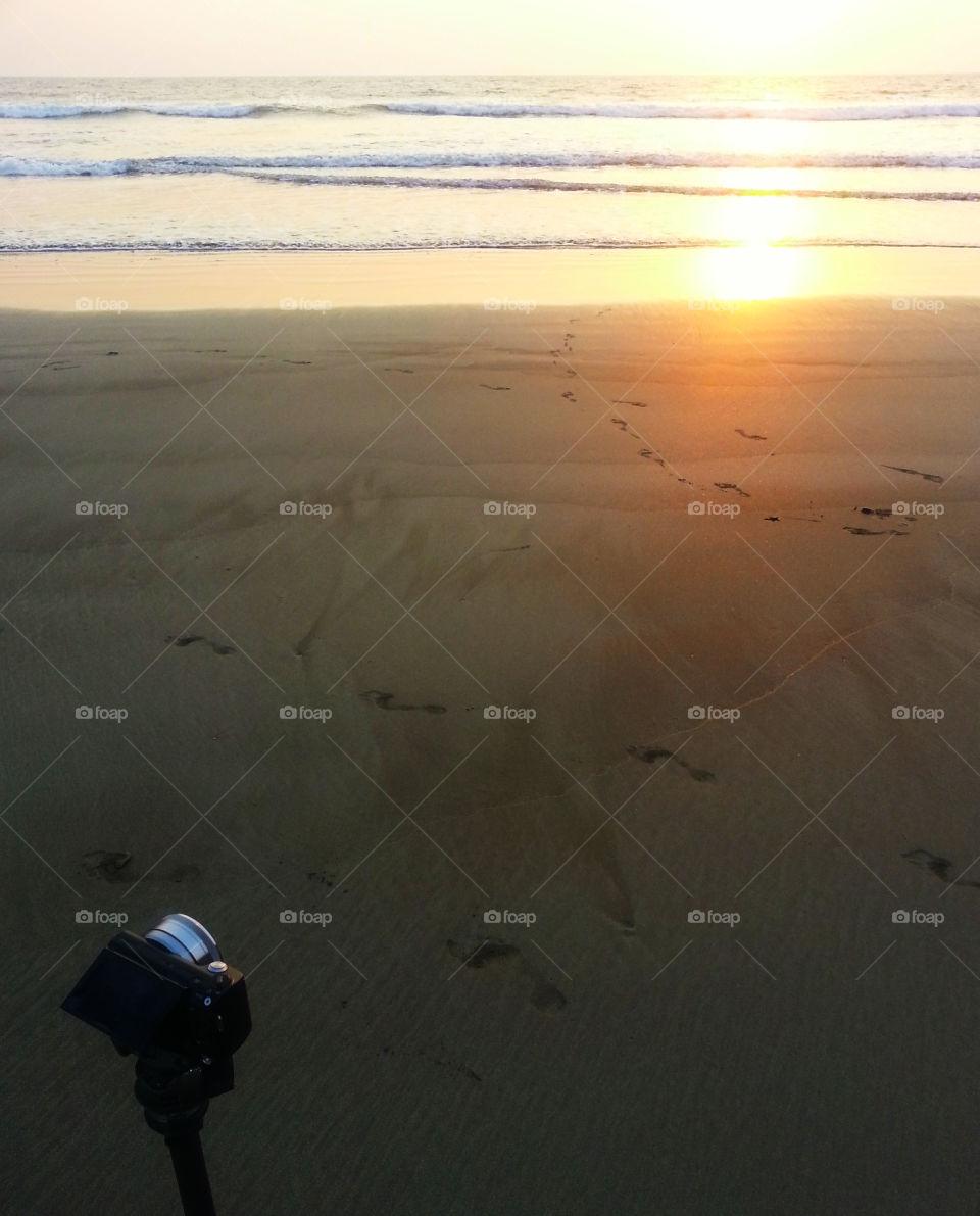 Camera meets ocean sunset