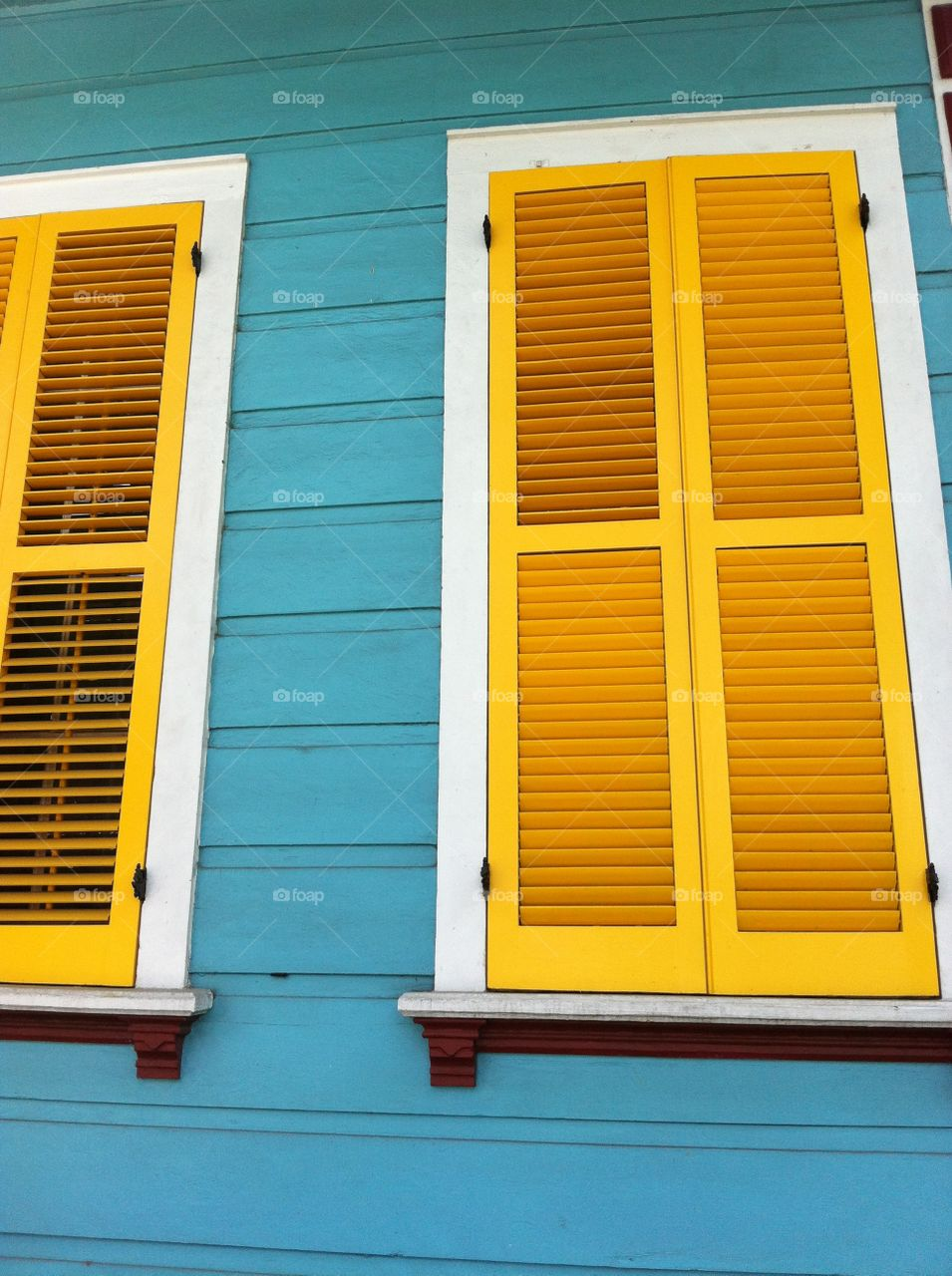 New Orleans. Yellow shutters on a blue house in New Orleans, Louisiana.