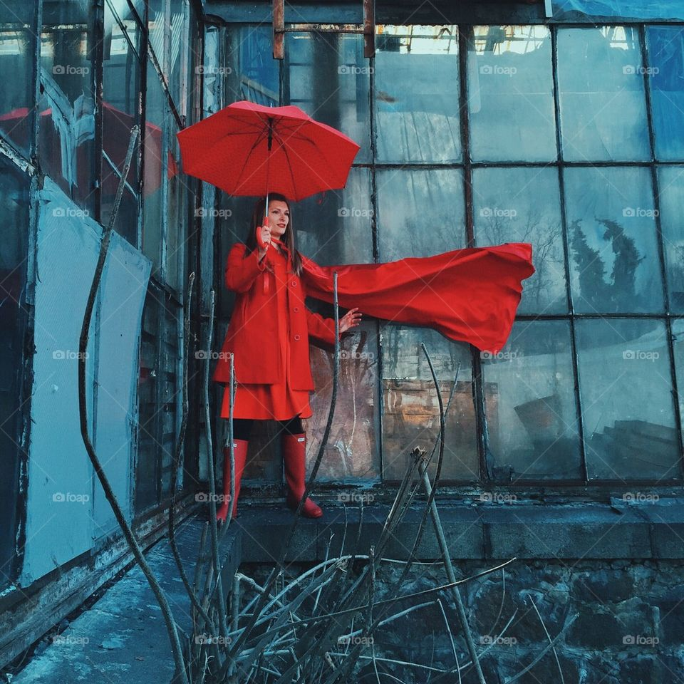 Superwoman in red with umbrella