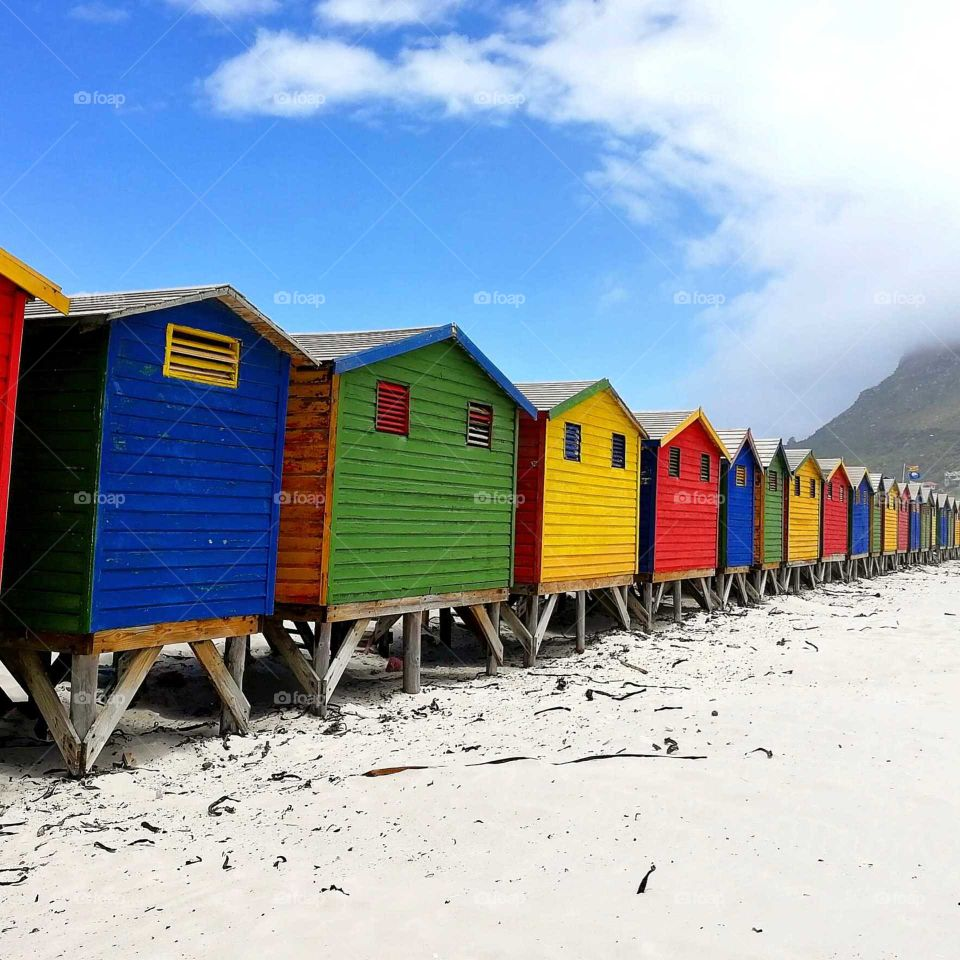 south Africa houses colored beaches red blue yellow green sand