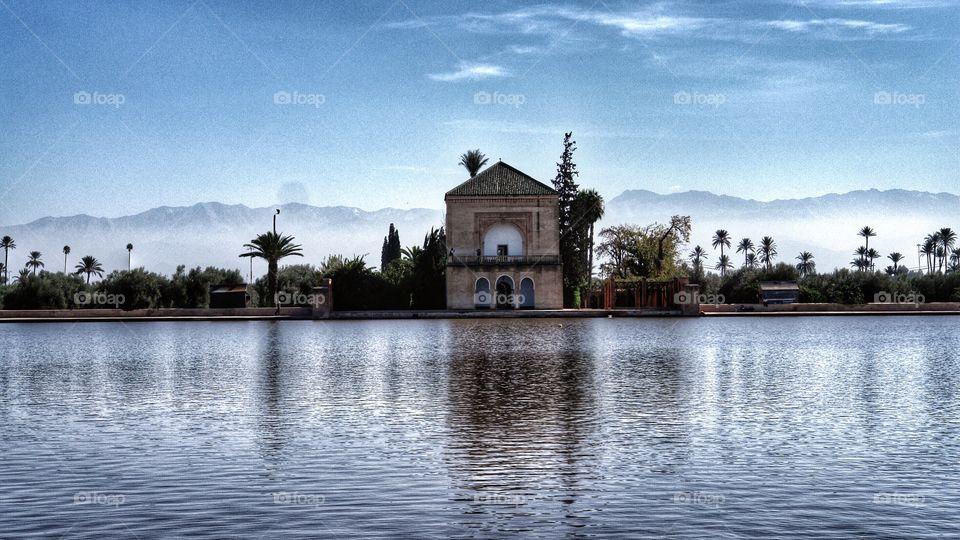 Menara Pavilion reflected on lake, Marrakesh, Morocco  . Menara Pavilion reflected on lake, Marrakesh, Morocco