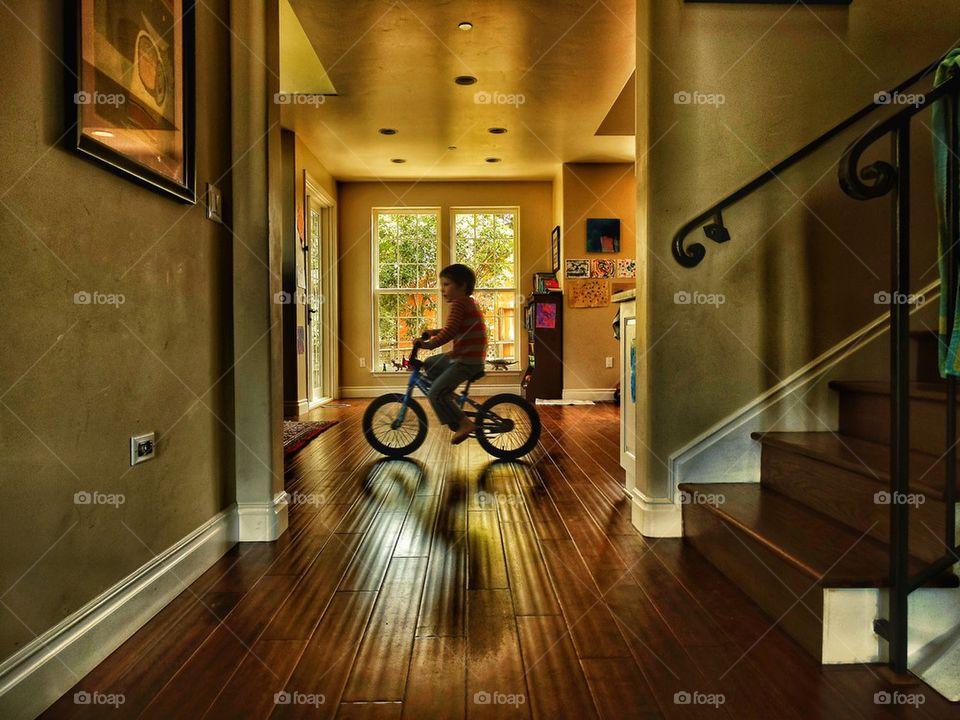 Child riding bike indoors