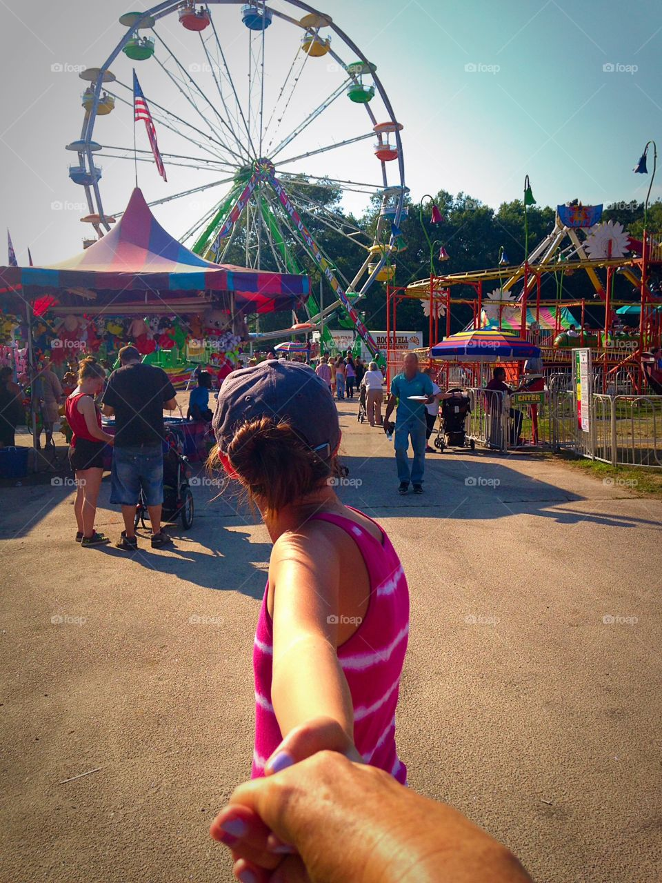 Follow me to the Ferris Wheel. Walking the midway at the county fair - follow me mission