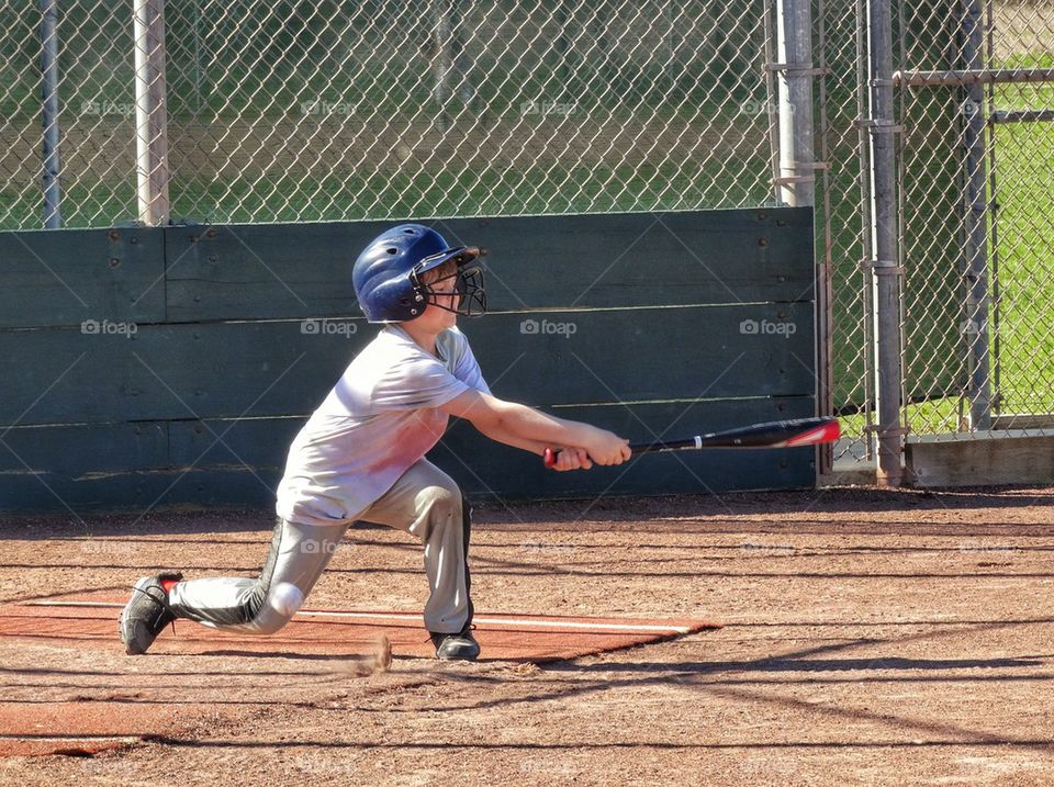 Little League Baseball Player Swings For The Fences. Youth Baseball In America