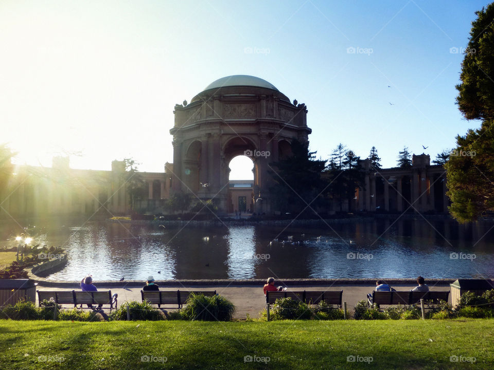 Palace of fine arts, San Francisco, people relaxing, sitting on a bench