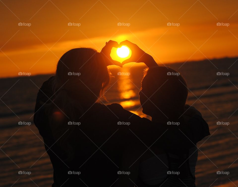Sunset Silhouetted in Love