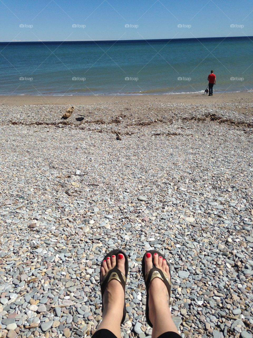 On the beautiful beach of Gaspesie looking at the shore of the St-Laurent Gulf
