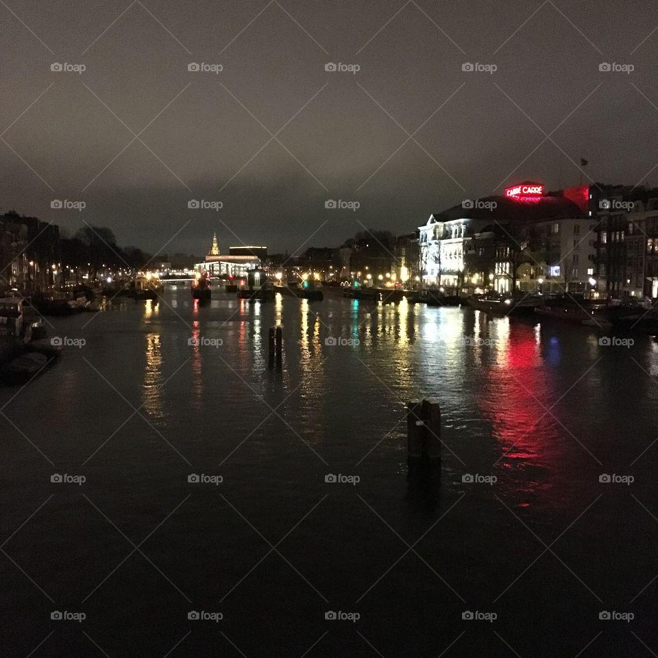 Amstel River by night in Amsterdam