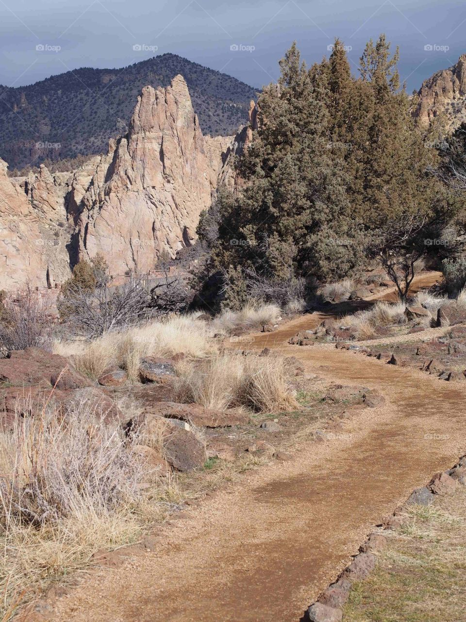 A nice dirt trail bordered with rocks goes through Smith Rock State Park in Central Oregon.