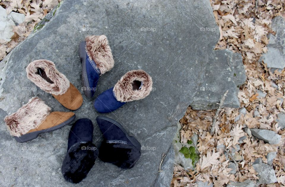 Circle of colorway slippers on a rock outdoors