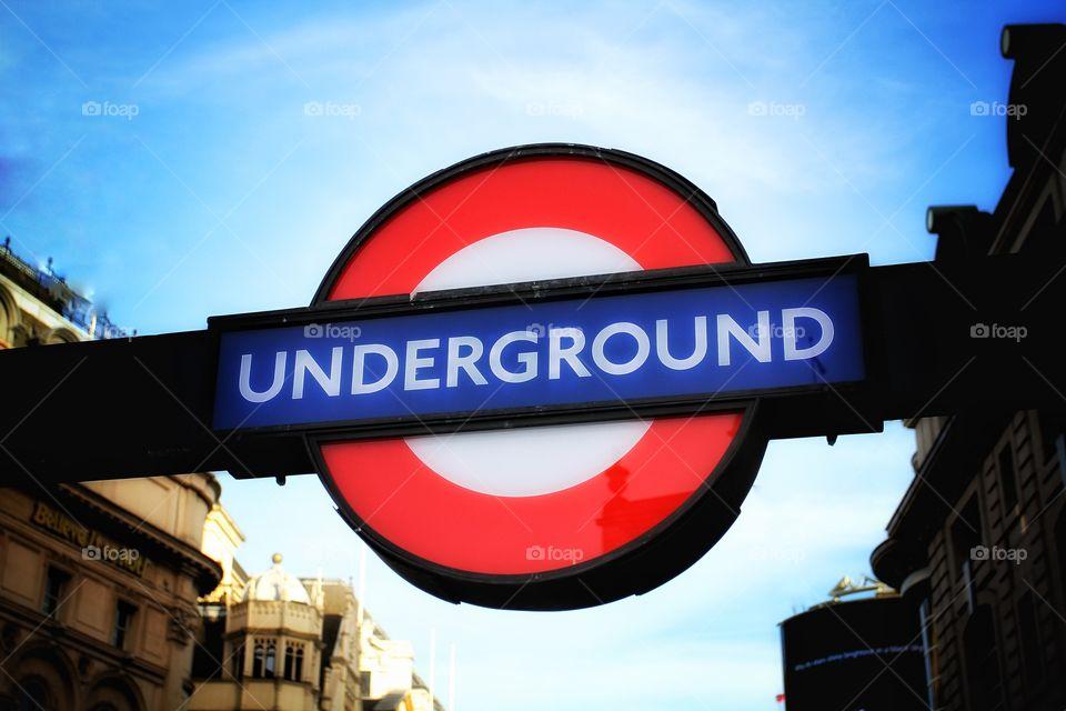 A London Underground illuminated sign.