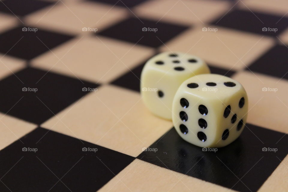 two dices on a chess board