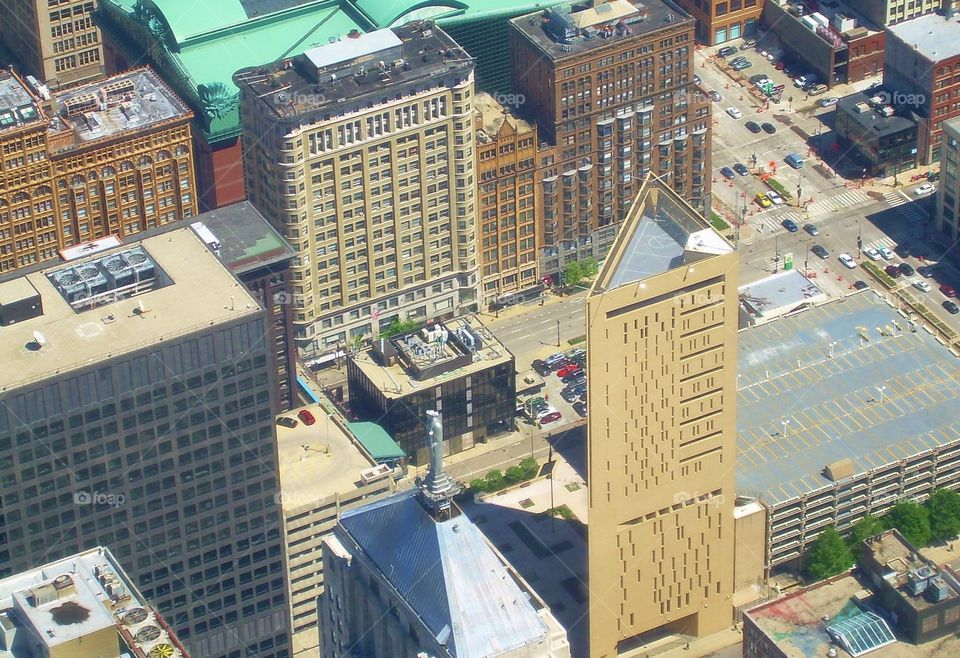 Looking down on Chicago, IL. The building that you see with the triangle roof, is a prison. You can see the basketball court from this picture.