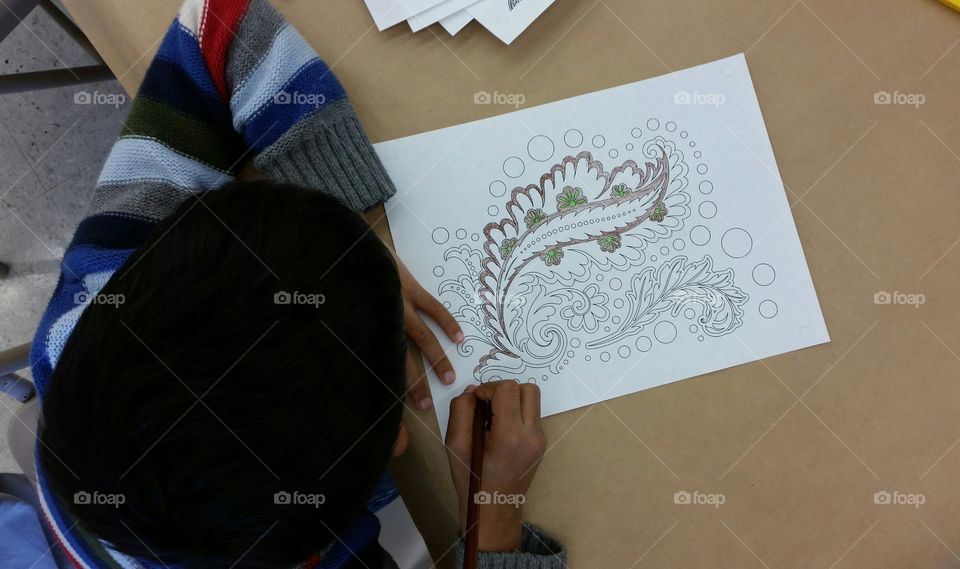 Kid coloring a pattern