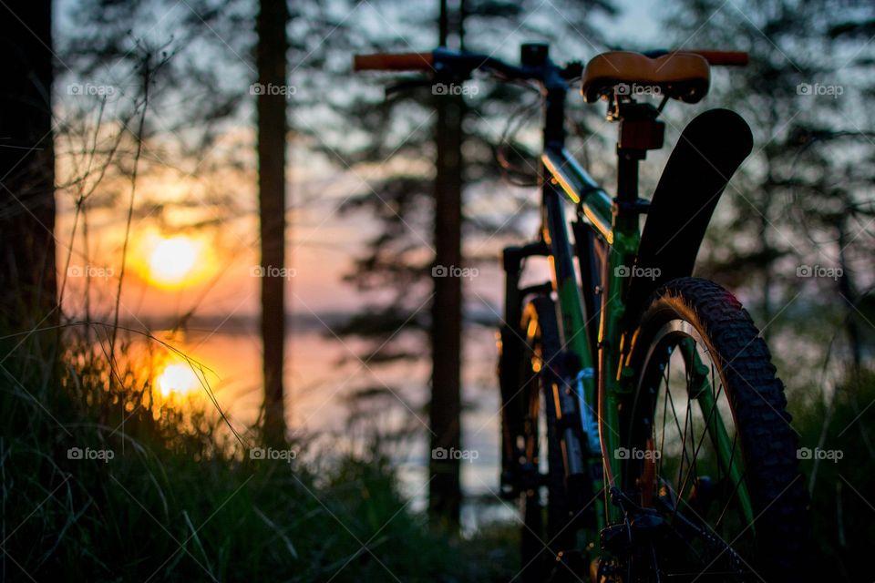 evening biking. sunset and bike