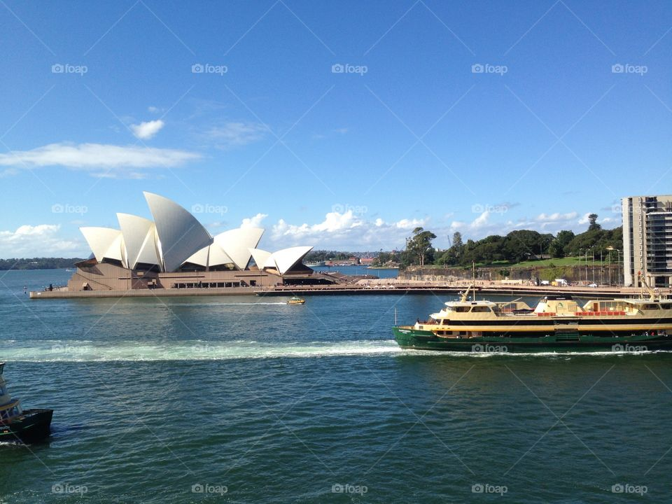A ferry passes the iconic Sydney Opera House