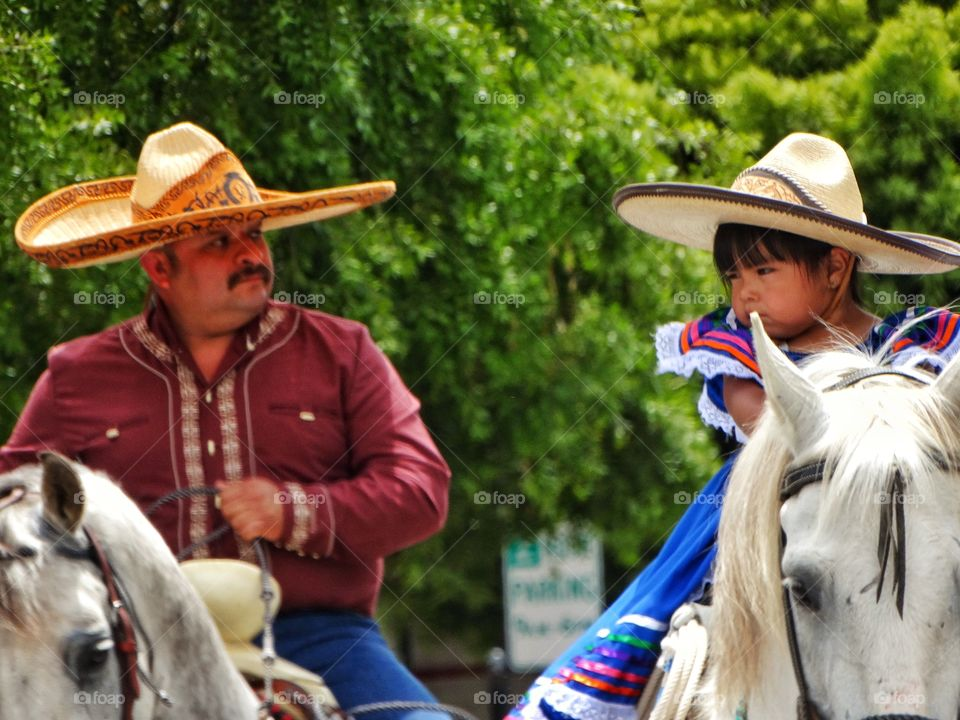 Cowboy Father And Daughter. Mexican Father With Young Daughter On Horseback