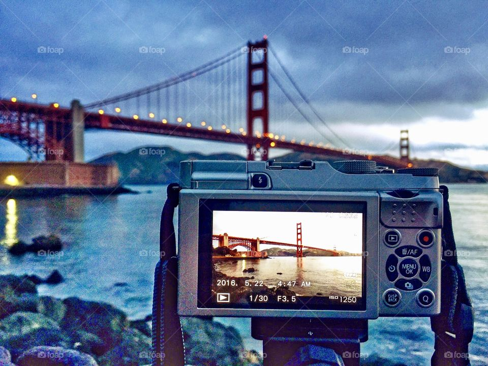 A photo display of a photographers camera taking a pic of the Golden Gate Bridge in San Francisco, CA.