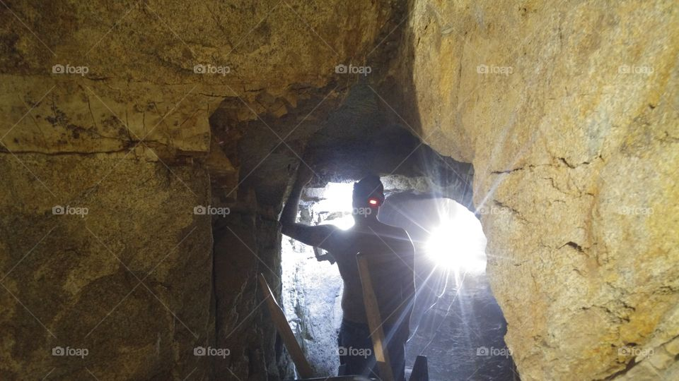 Underground Miner Prospecting For Gold