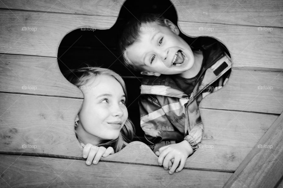 Funny kids. Two cute kids playing around