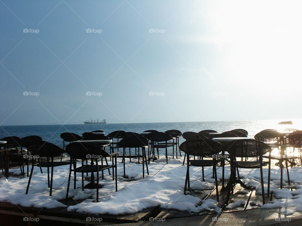 Snow, Chairs and the Sea