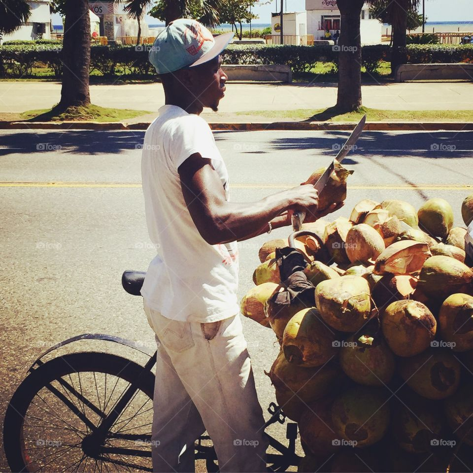 Coconut seller at side of road