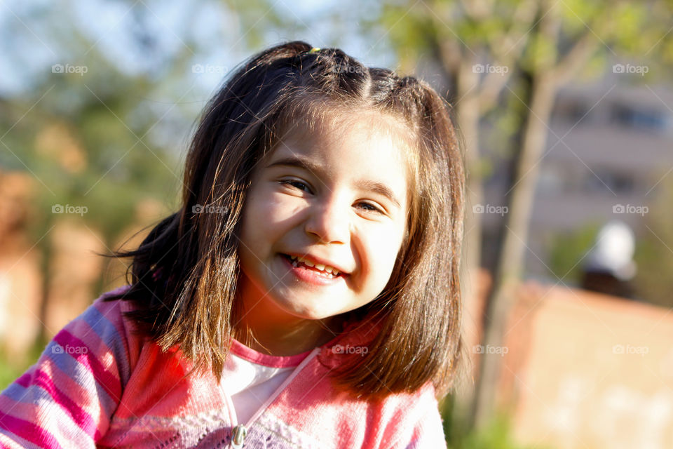 Portrait of a cute smiling girl