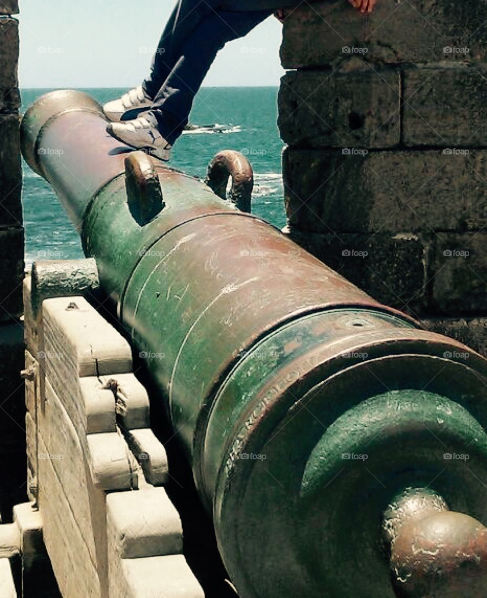 Old cannon overlooking the sea