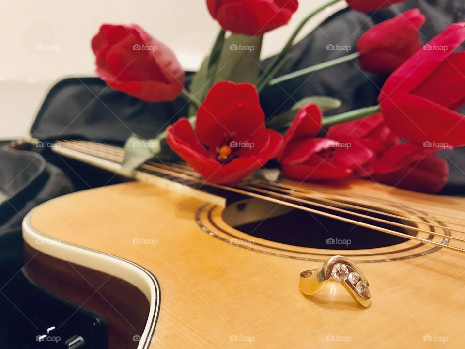 Taking a weekend getaway to propose to the love of my life by serenading her with my guitar!