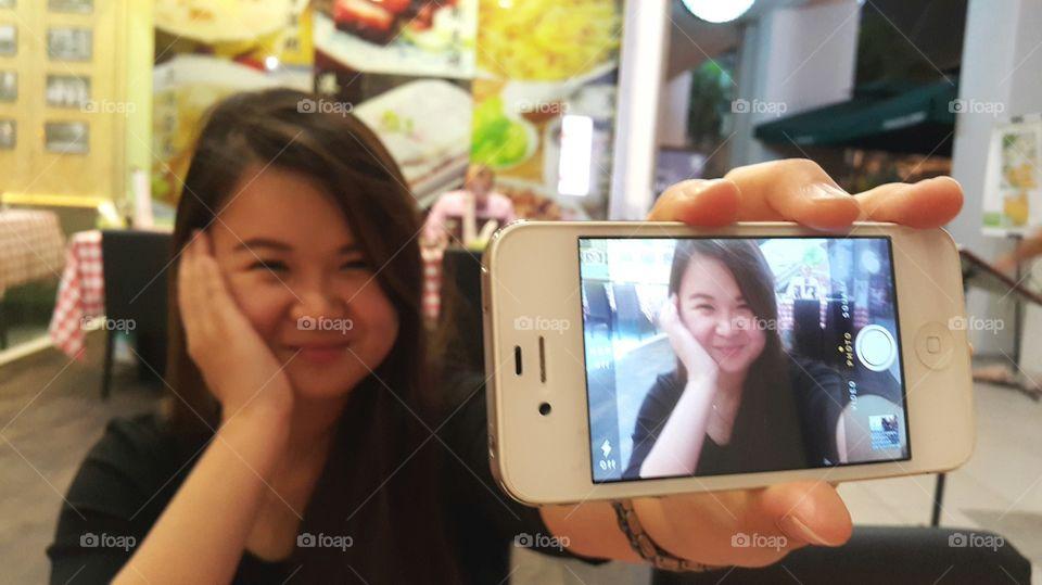 Girl taking selfie on cellphone