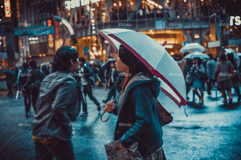 Hold onto the moment. Snap - busy streets, the drizzle of Tokyo's peeps always in style. Even their umbrellas are on point