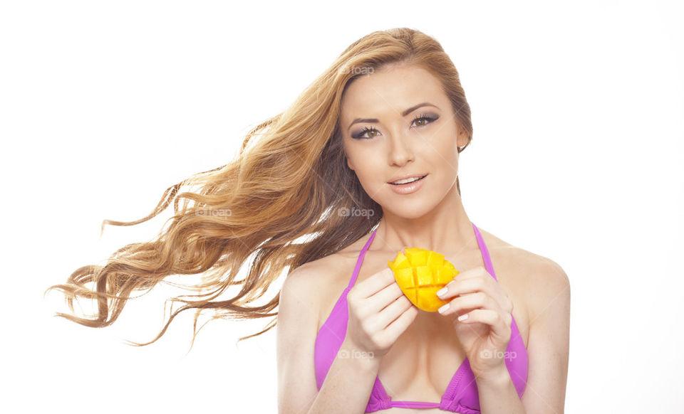 Beautiful girl with mango fruit