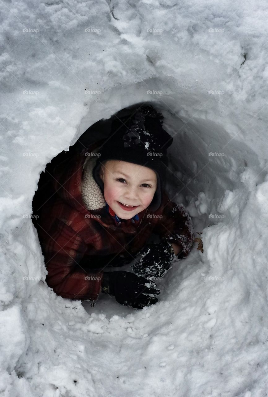 Boy in snow cave