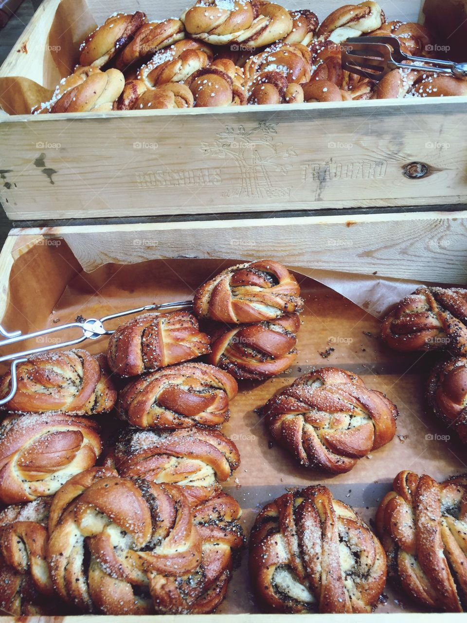 Cinnamon buns in wooden boxes