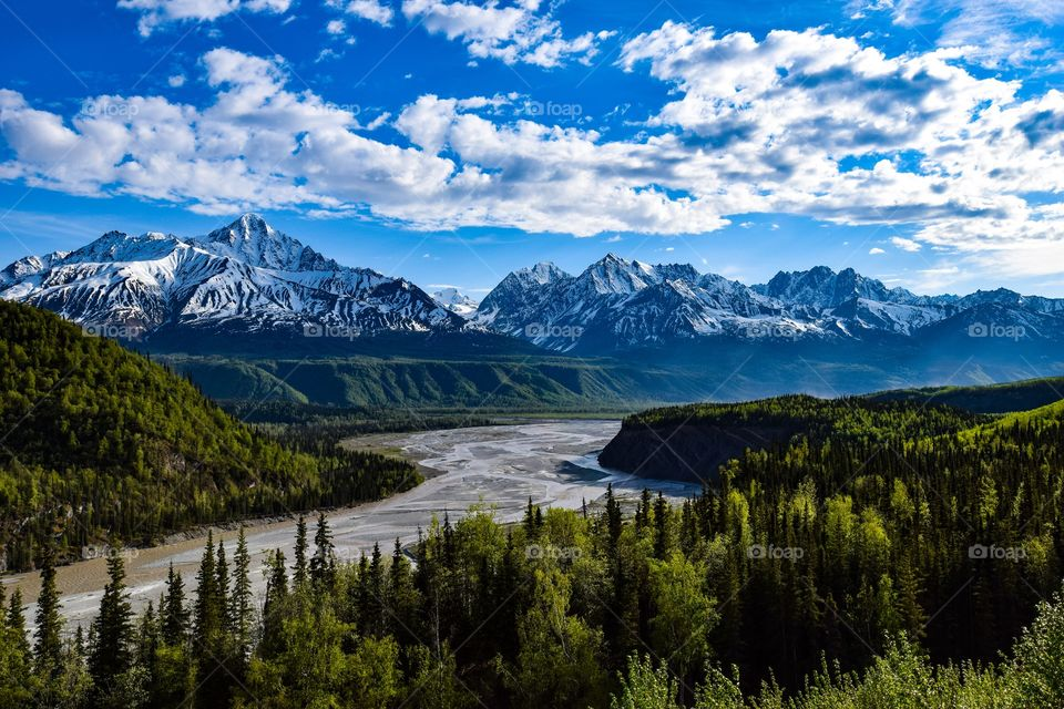 A beautiful view of the Matanuska River and the mountains along side about 20-30 miles outside of Palmer, Alaska
