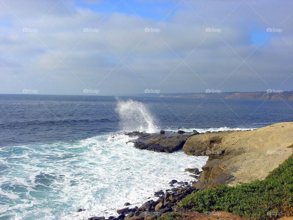 breaking wave on the rock