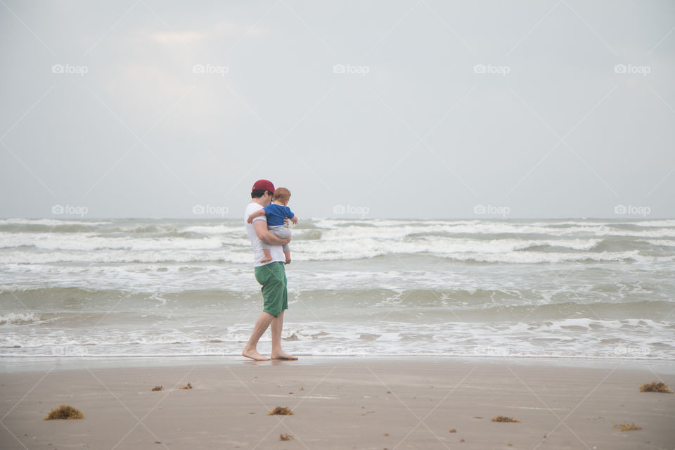 Father and baby at beach