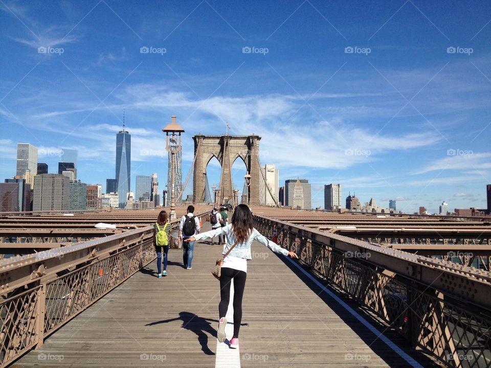 Happy Brooklyn bridge . Happy woman On the Brooklyn bridge